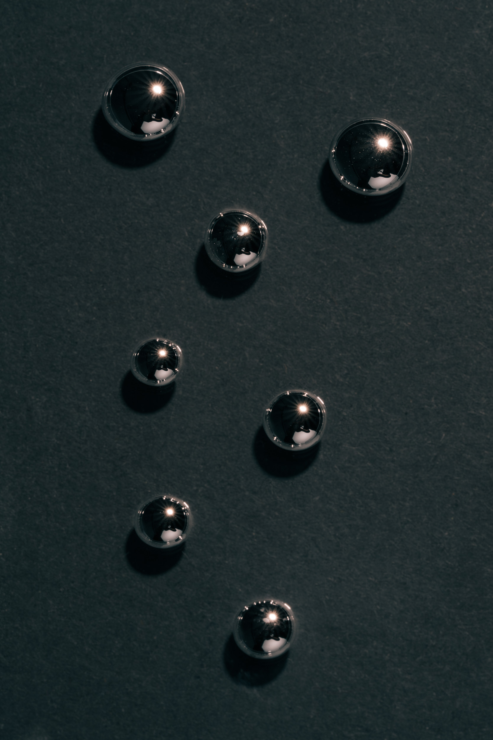 Beads of mercury on table