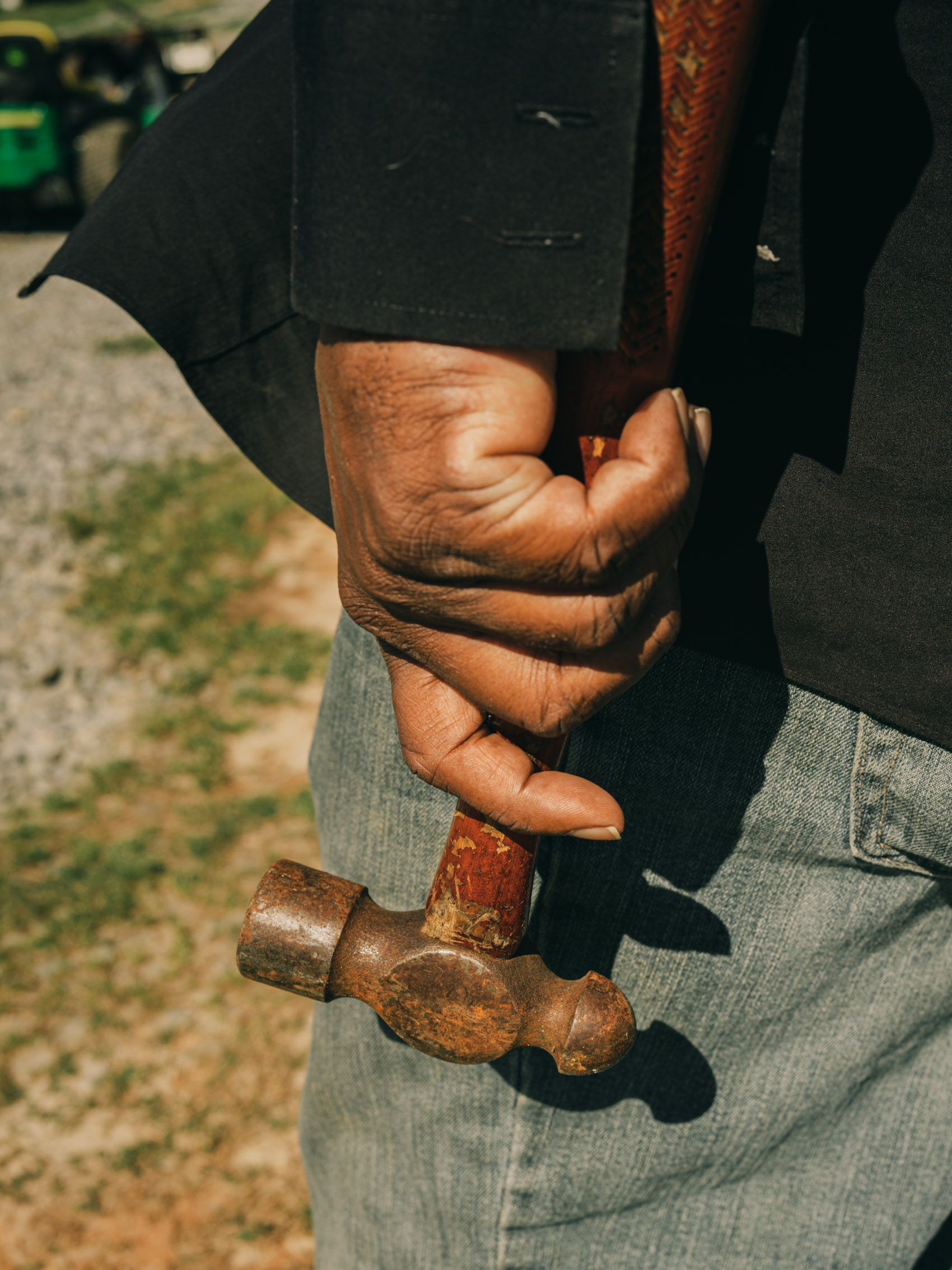 farmer carrying a hammer