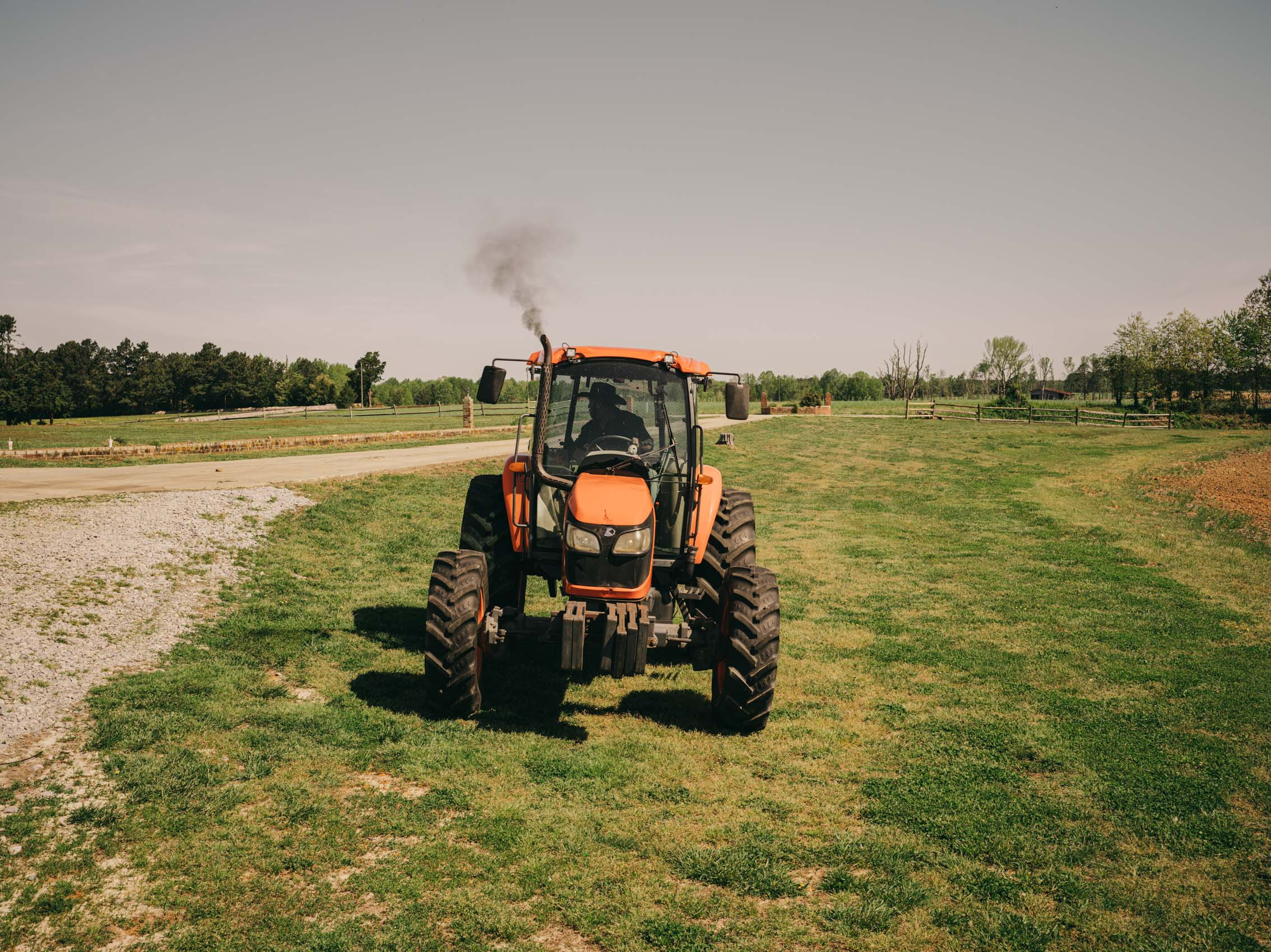 farmers uses tractor on crops