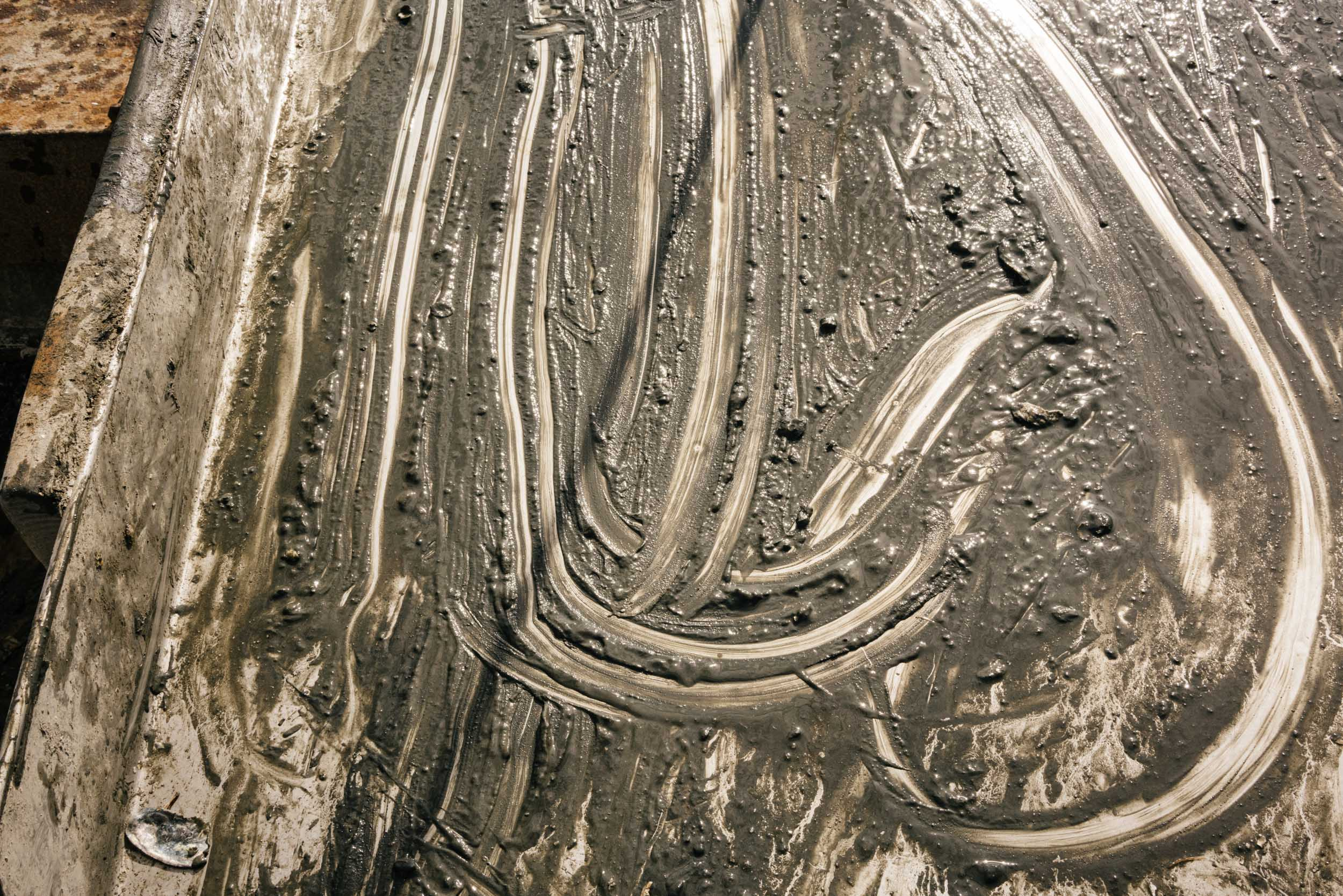 mud streaks on metal table