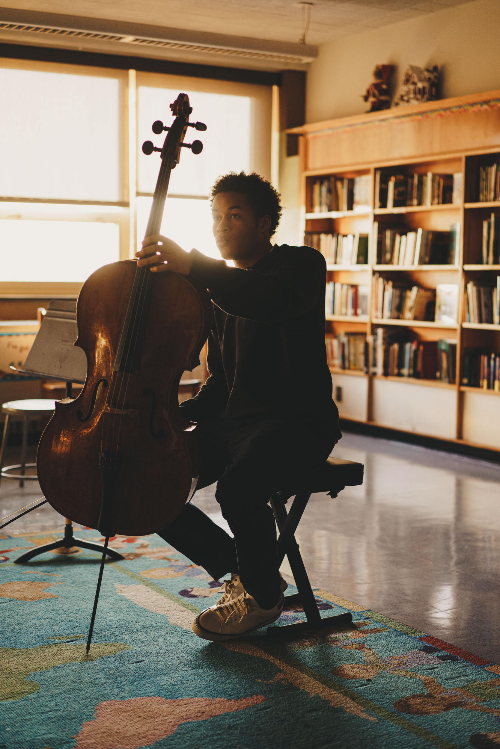 Sheku Kanneh-Mason, a famous cellist from London, practices in a classroom at Mary Ann Winterling Elementary School