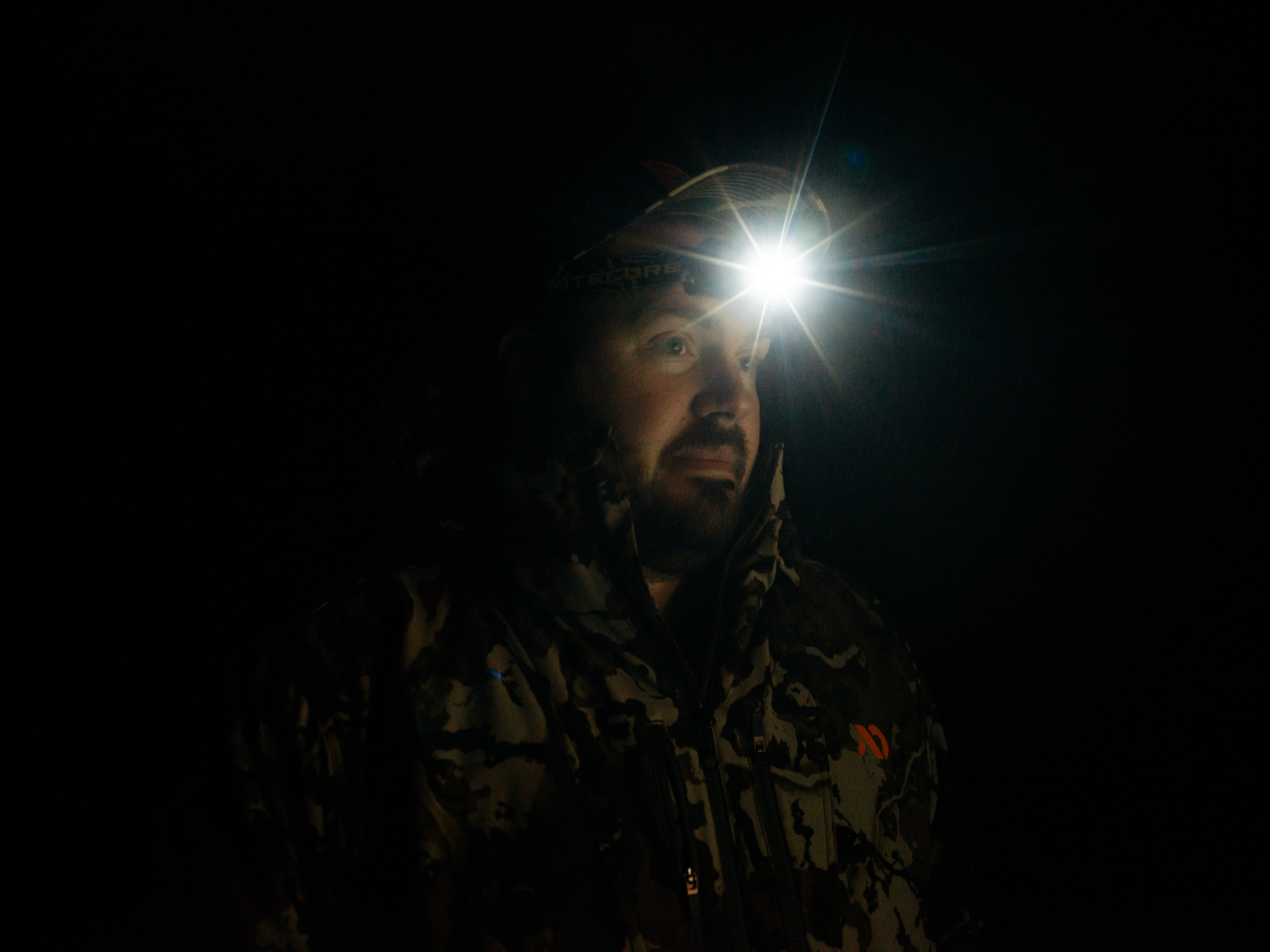 Deer Hunters with headlamp on head at night