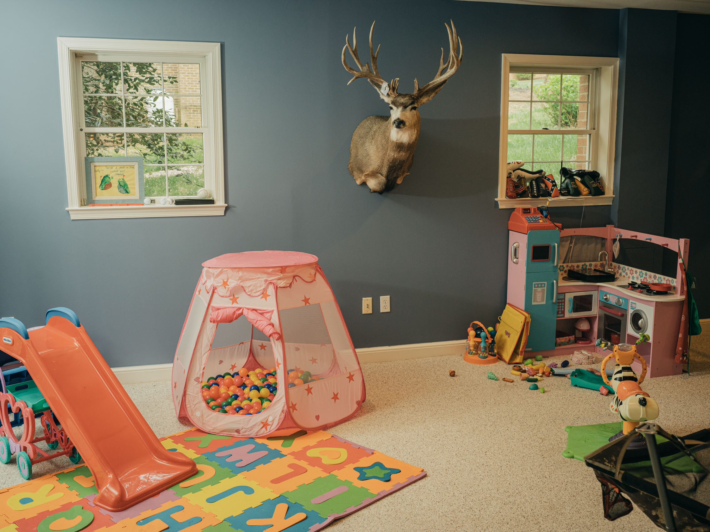 Deer mounted head in kids playroom