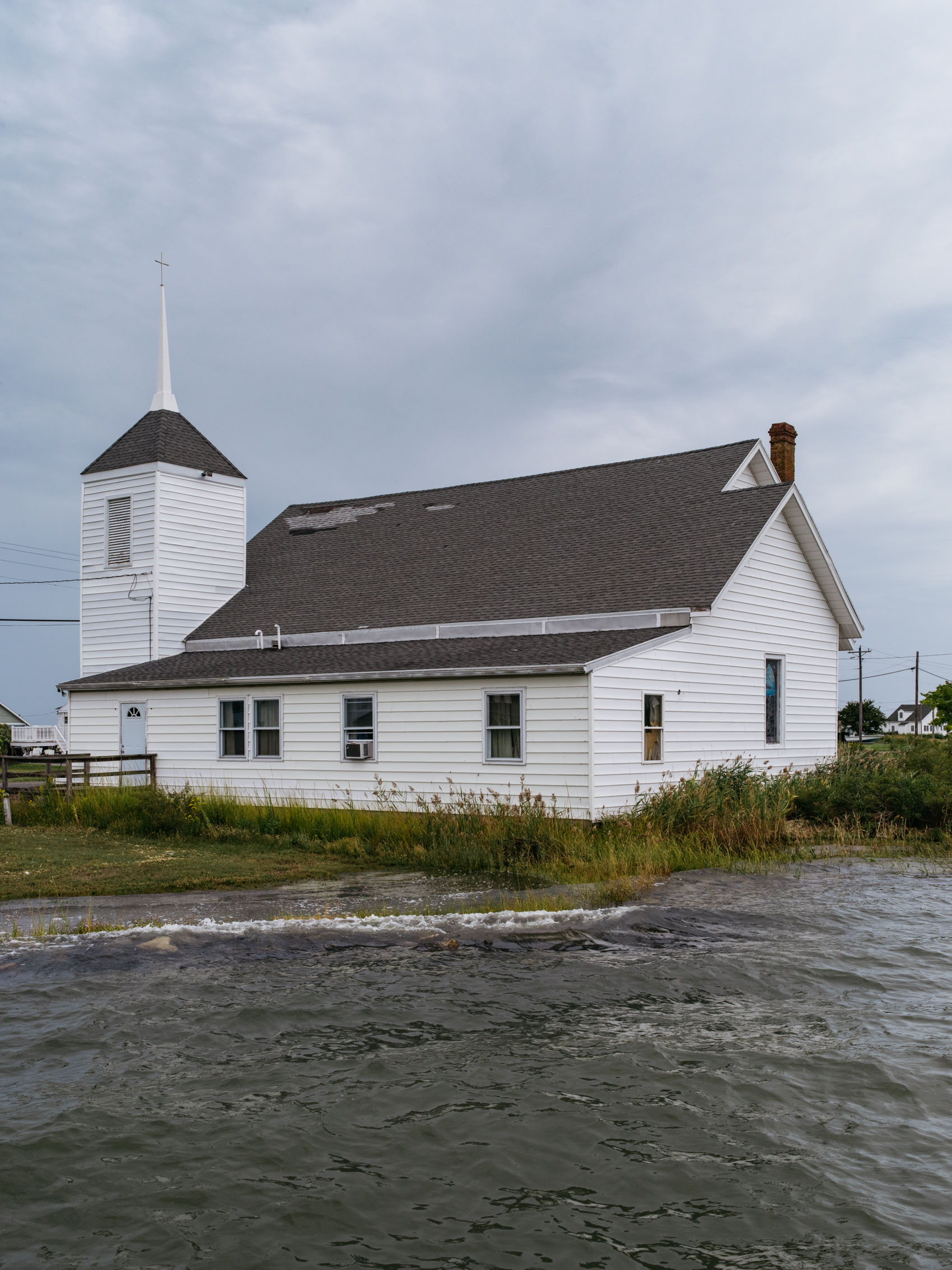 church with sea level rise issues water up to back door