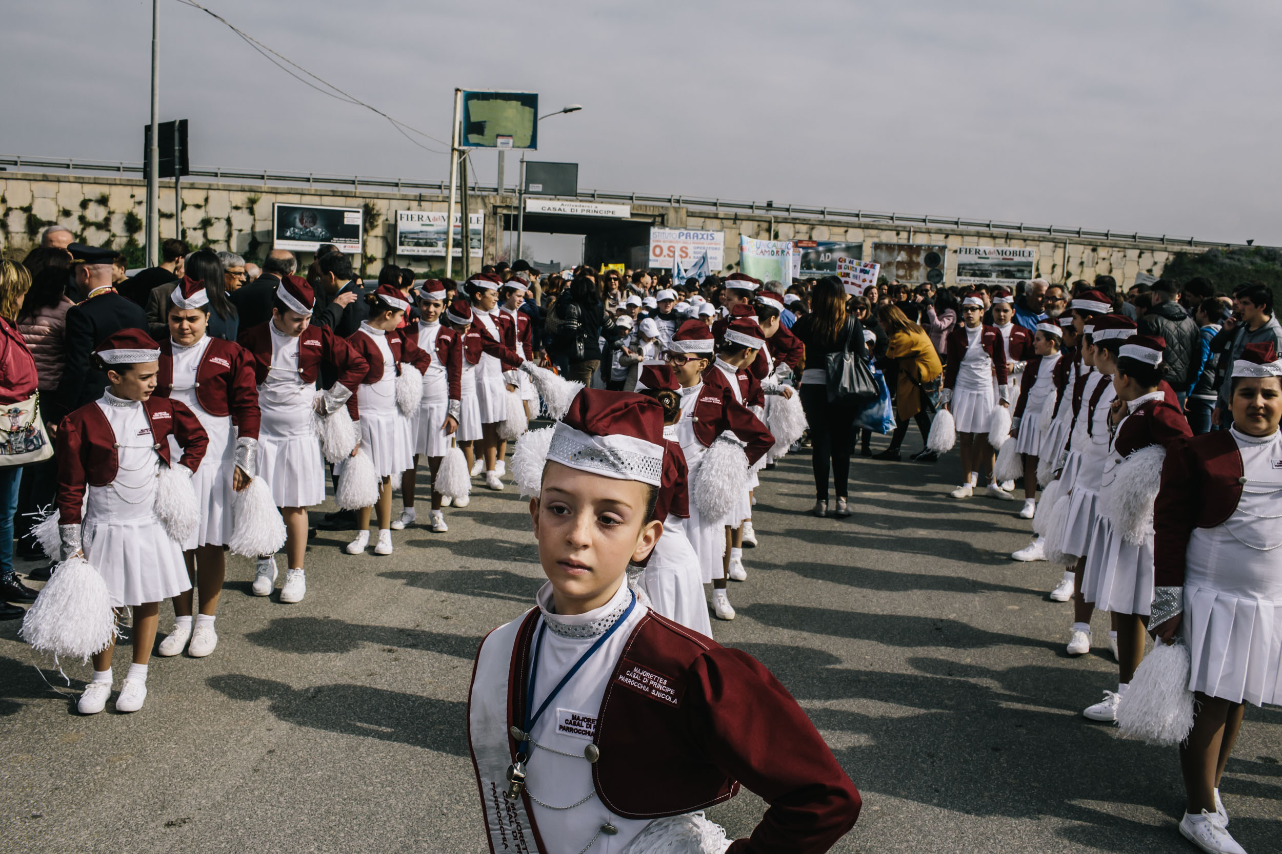 Children in a marching group stand in formation before the start of a protest