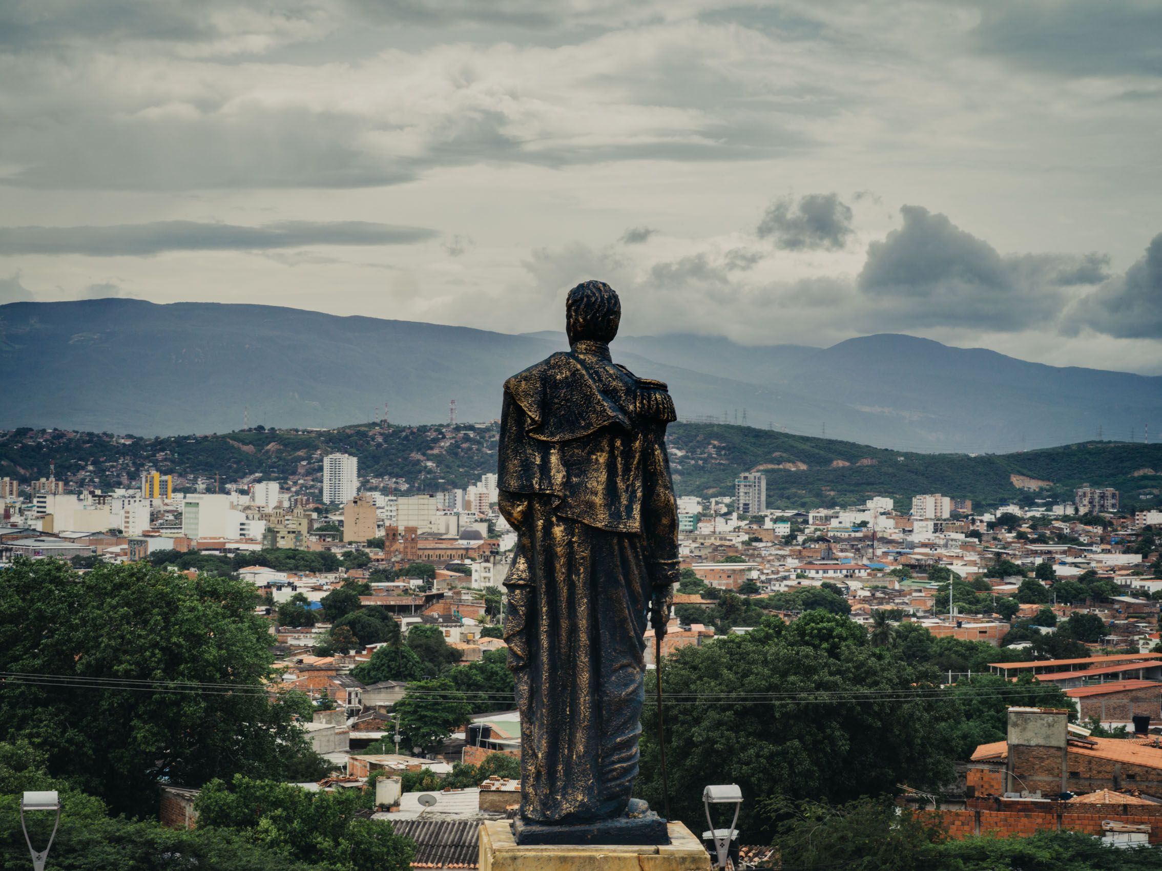 A statue of Simón Bolí­var stands atop a hill overlooking the city of Cúcuta, Colombia