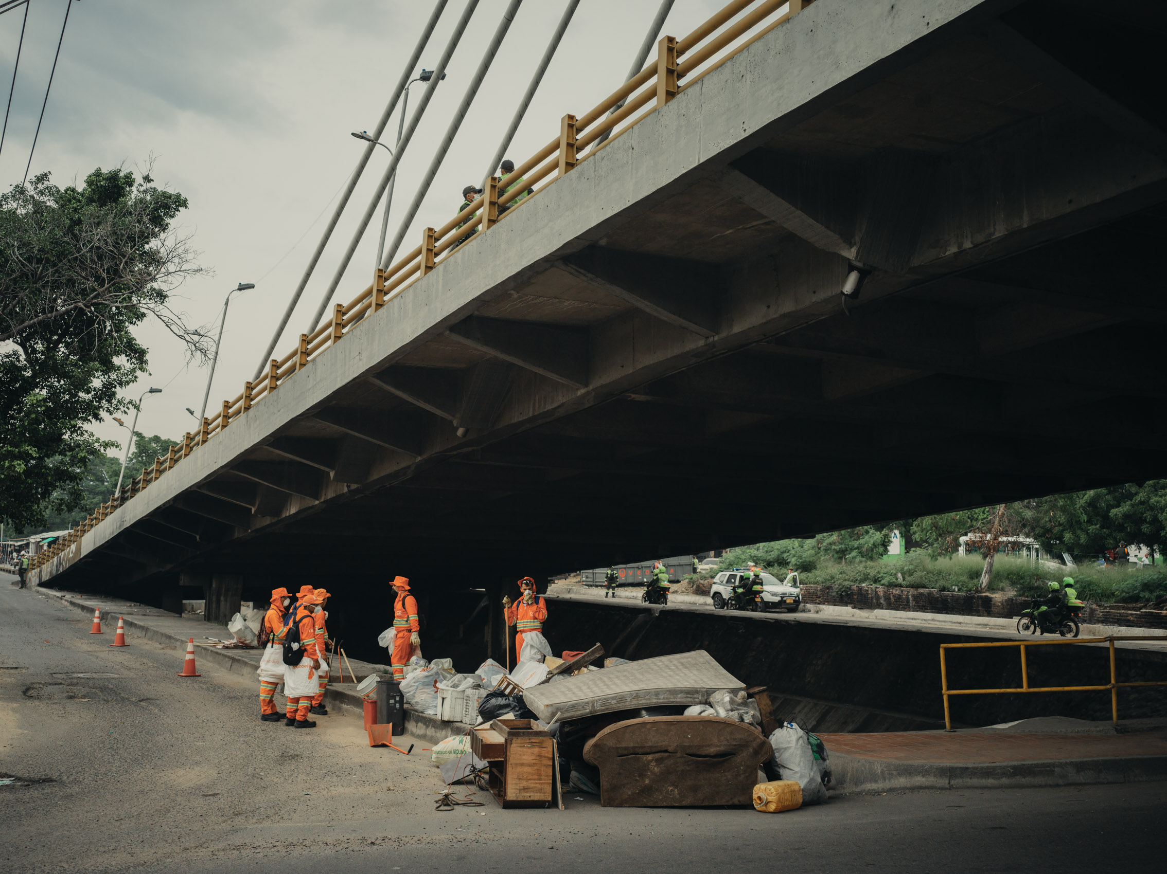 Trash cleanup under bridge in Colombia