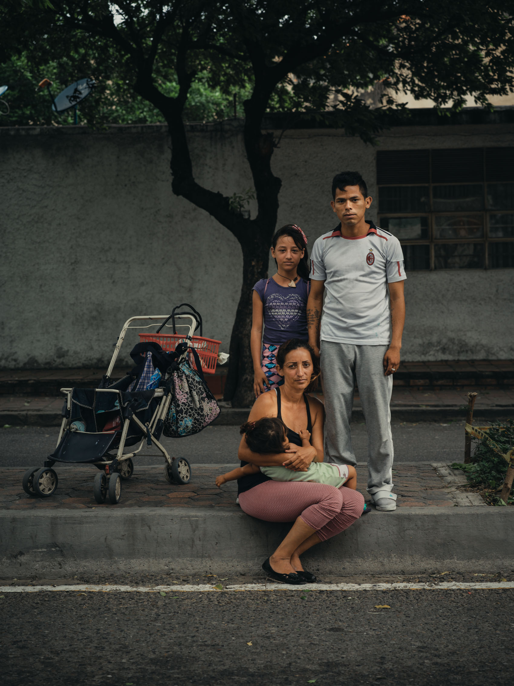 portrait of homeless family from Venezuela