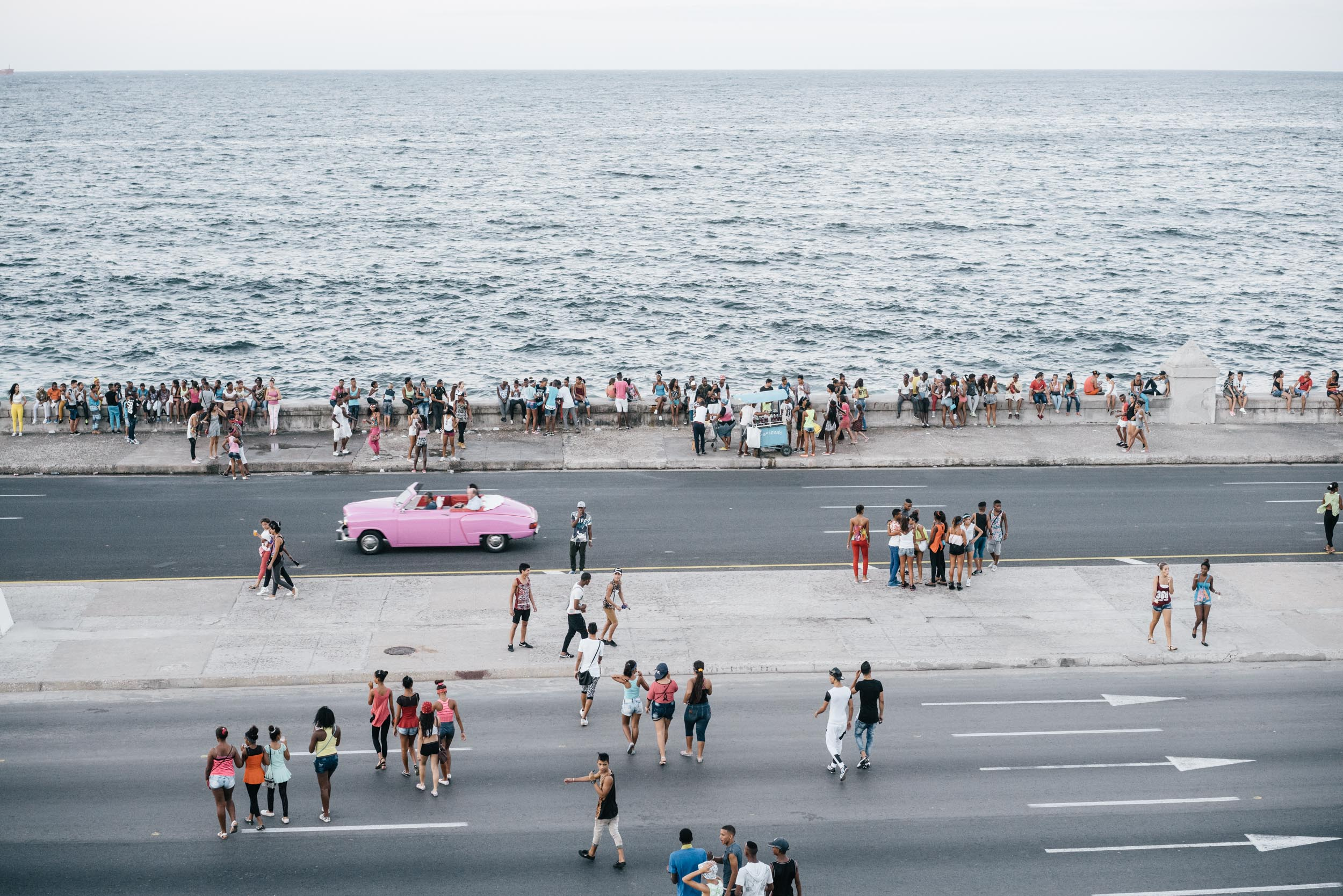 Young Cubans gather along the Malecon in Havana