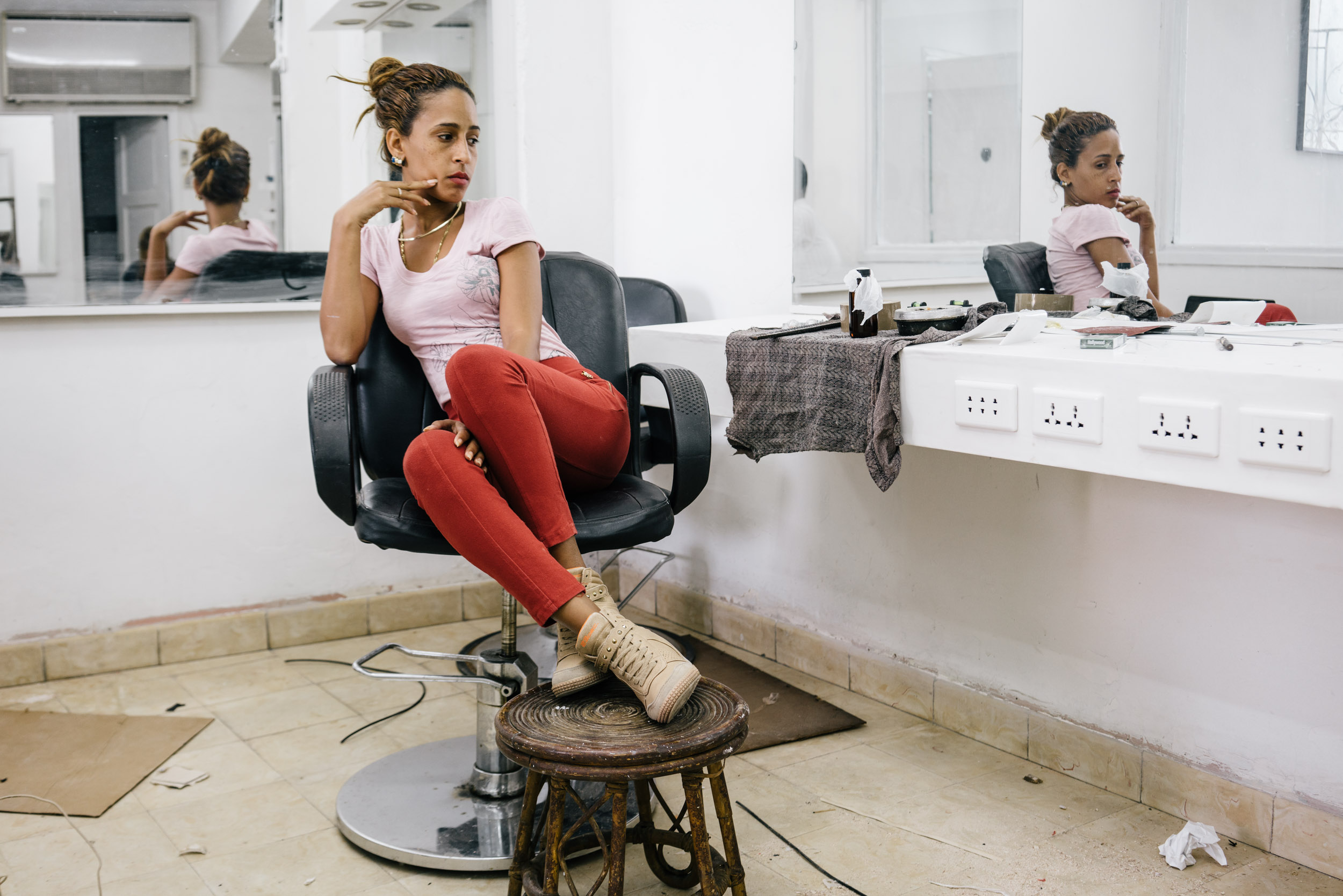 woman sitting on chair in beauty salon