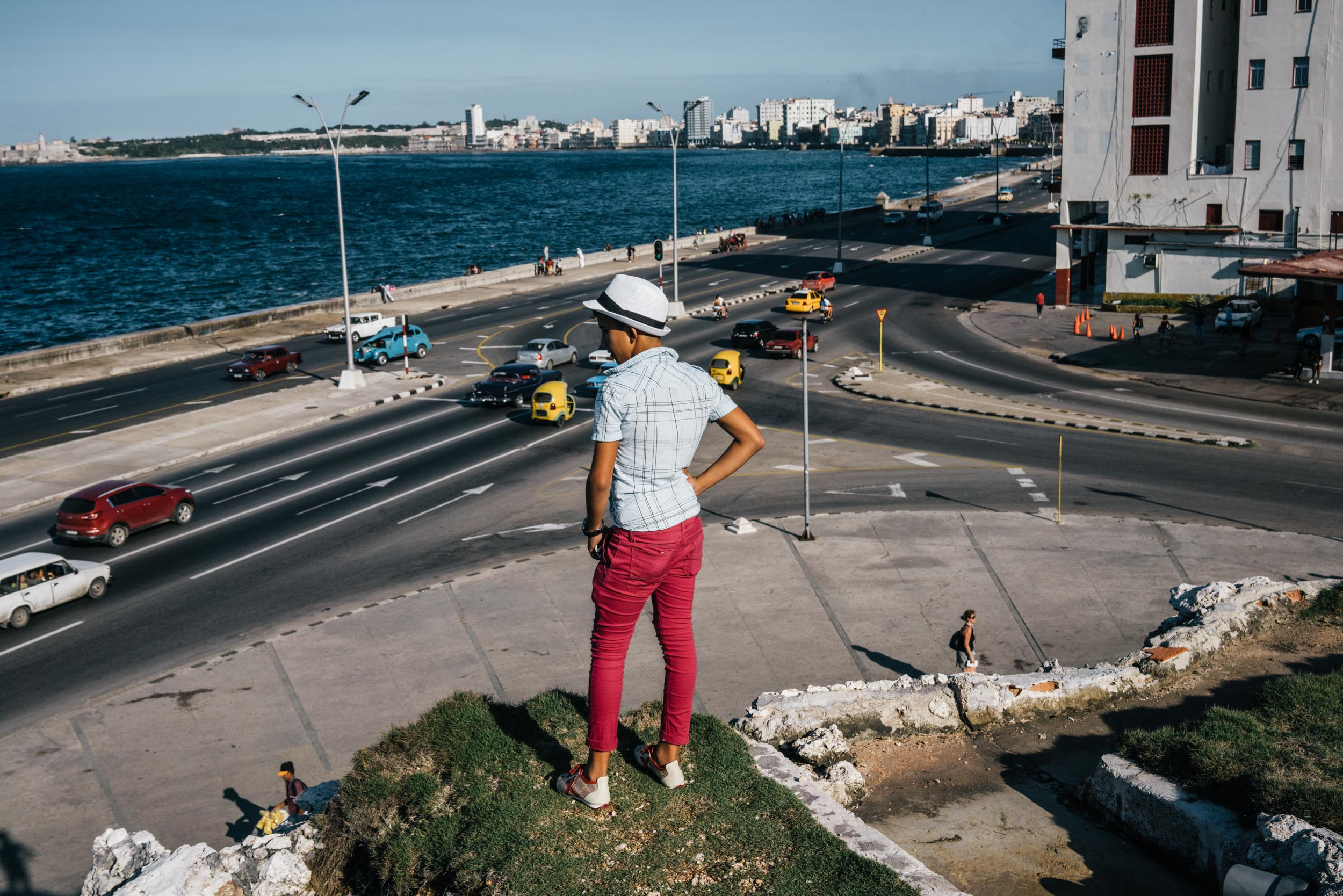 teenager standing on hill overlooking Havana