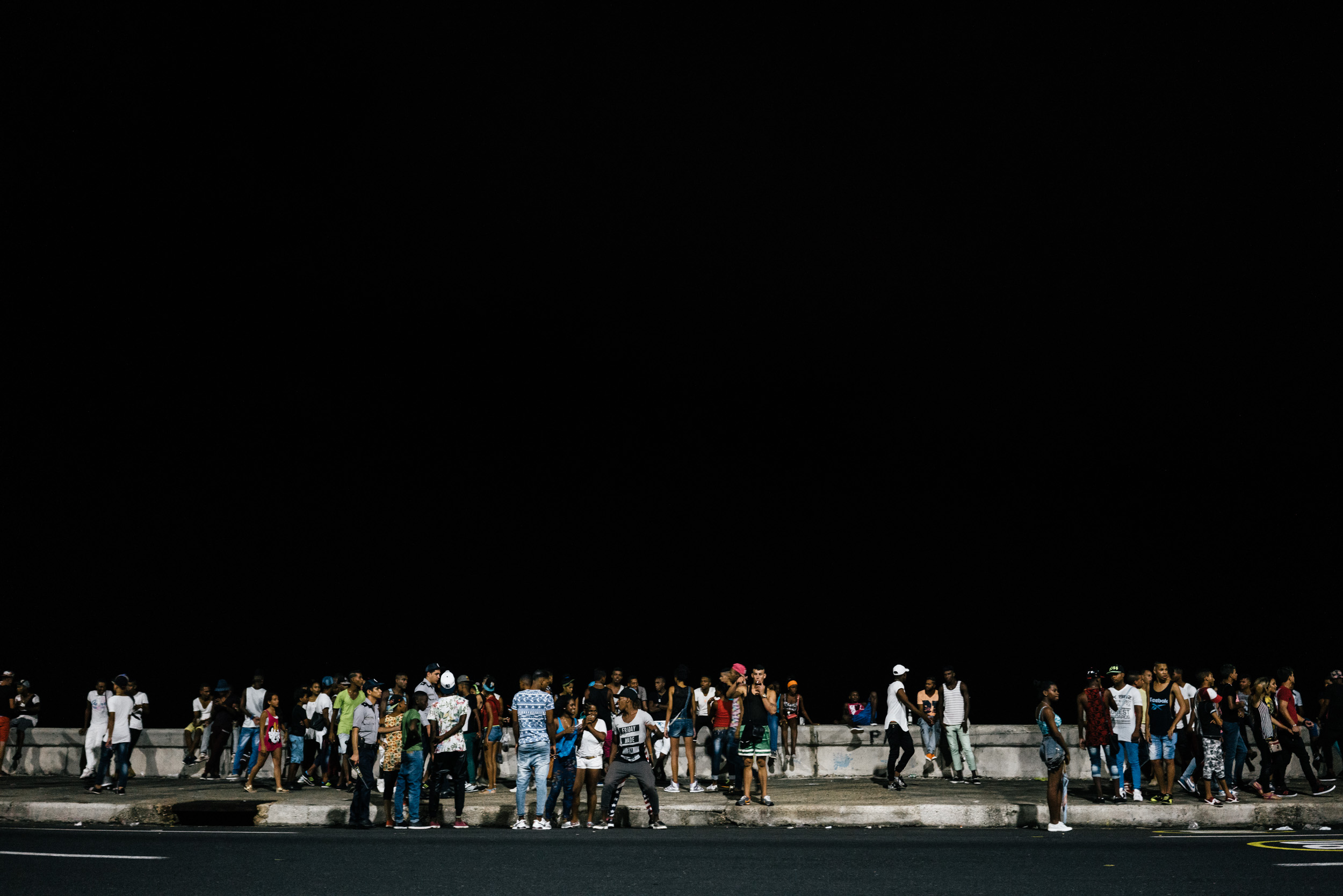 crowd partying at night along the Malecón in Havana