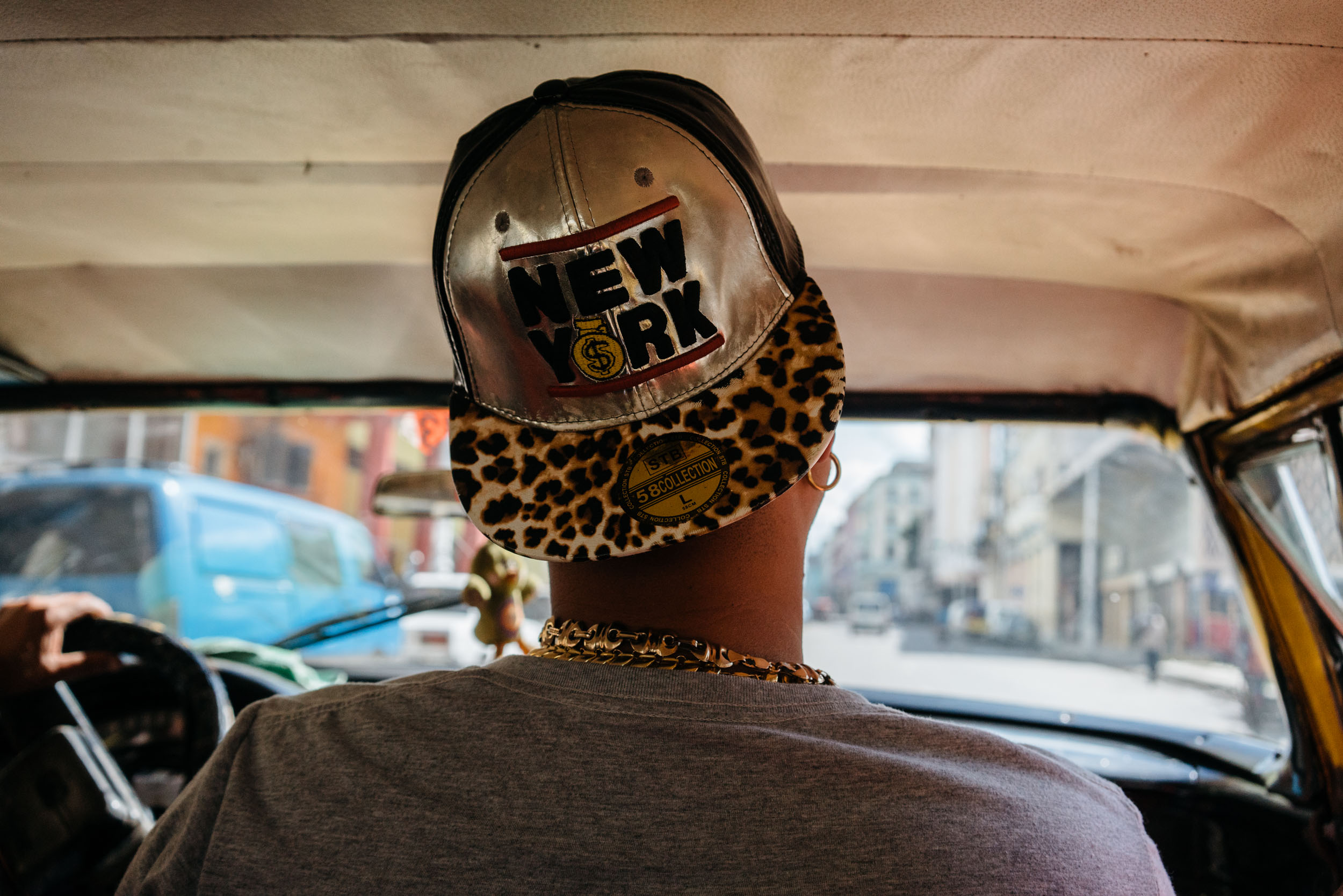 inside taxi havana cuba hat with new york