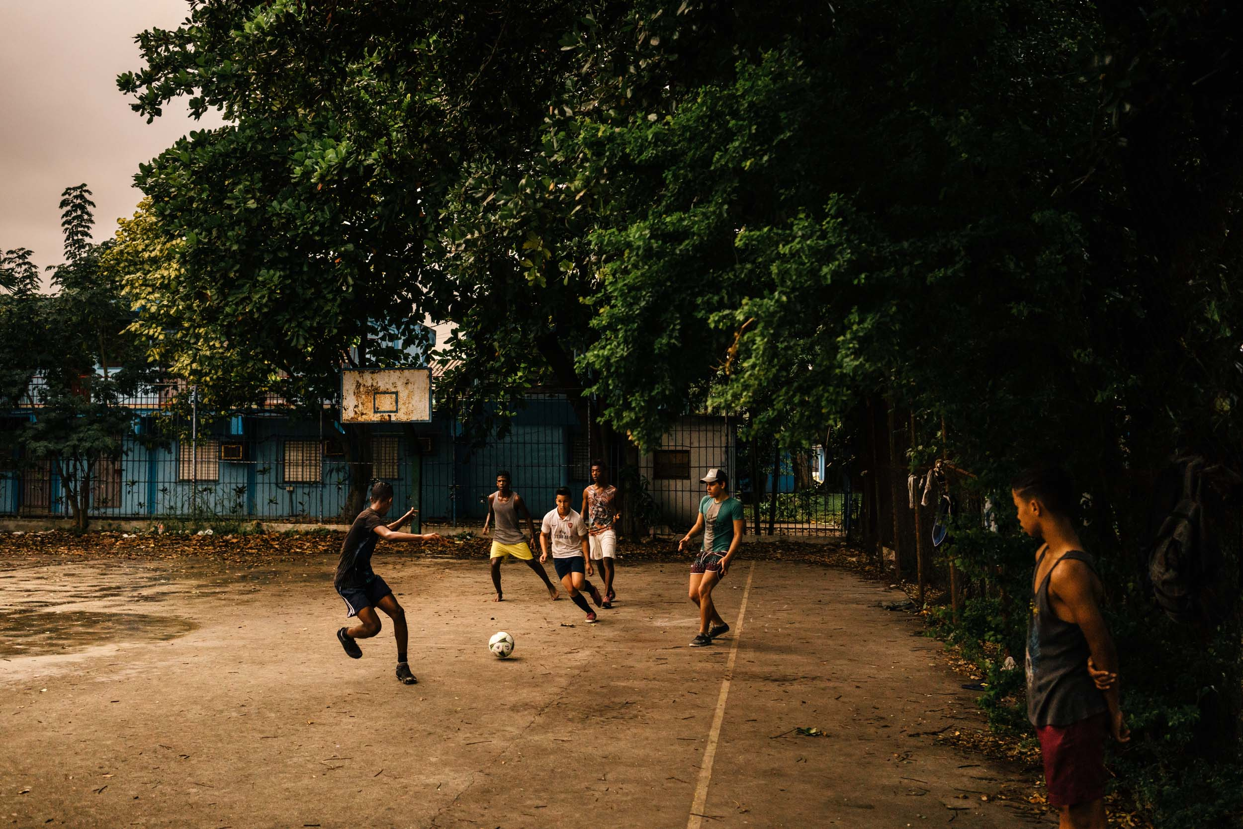 cubans playing soccer on basketball court