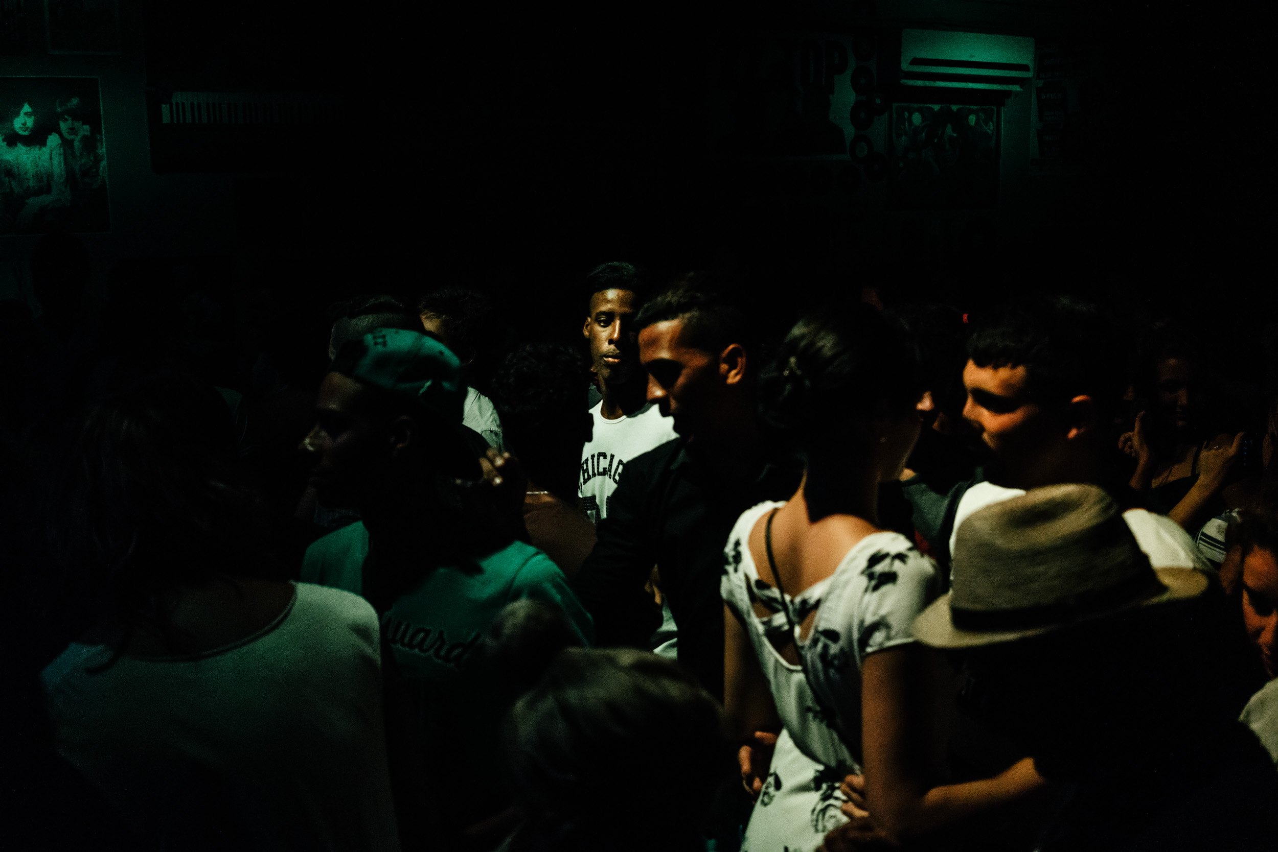 cubans at night club in Havana dark
