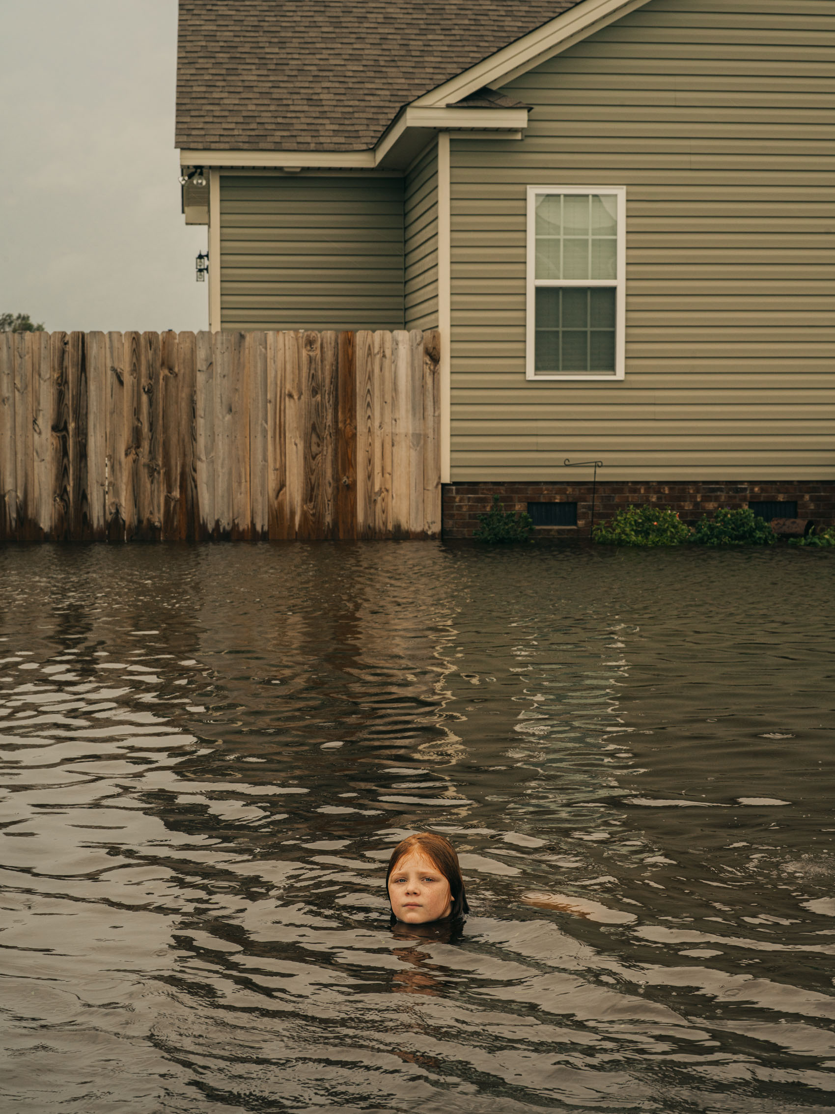portrait of girl in flood waters of Hurricane Florence