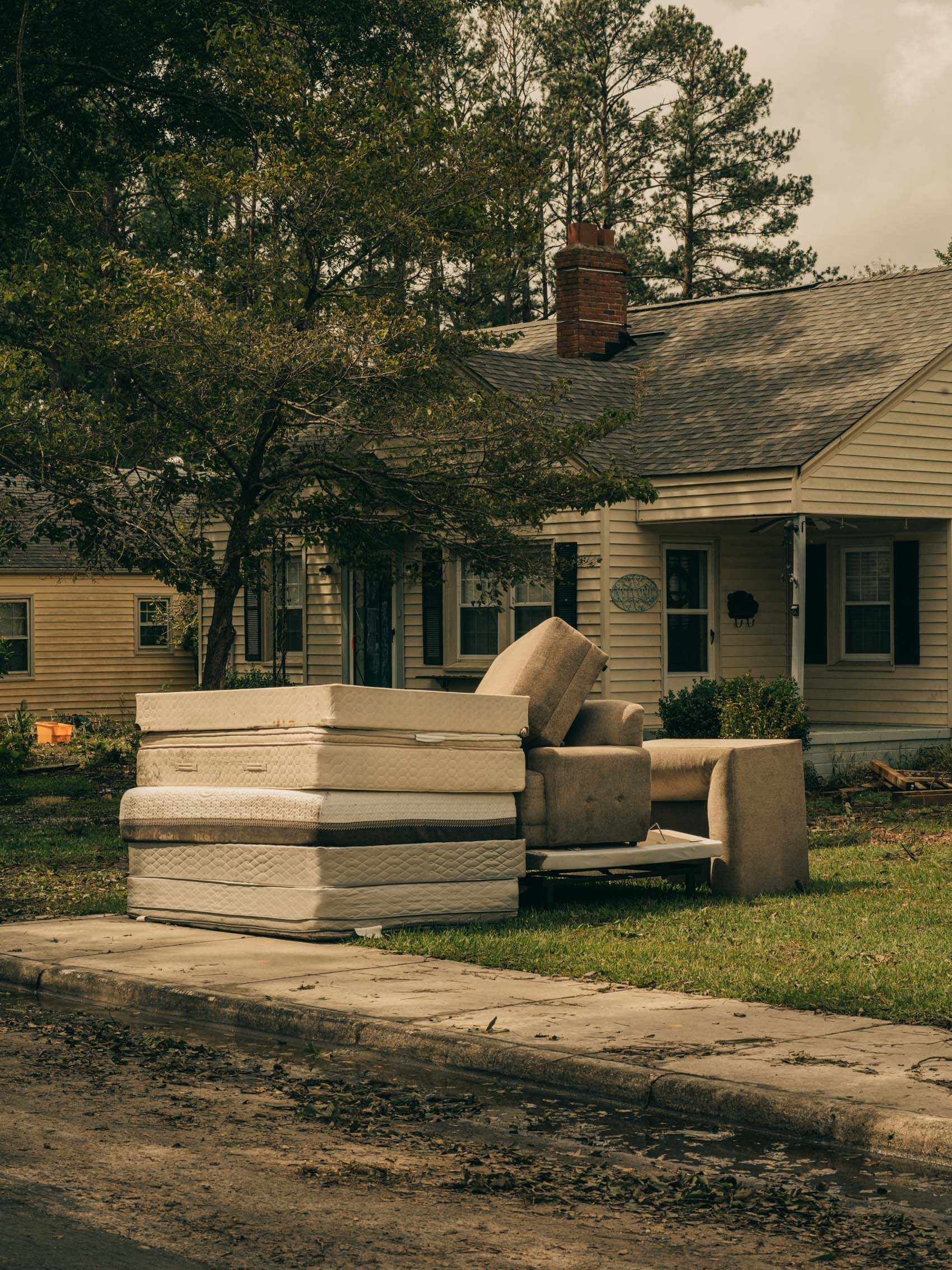 Water logged furniture stacked outside of a home after hurricane florence