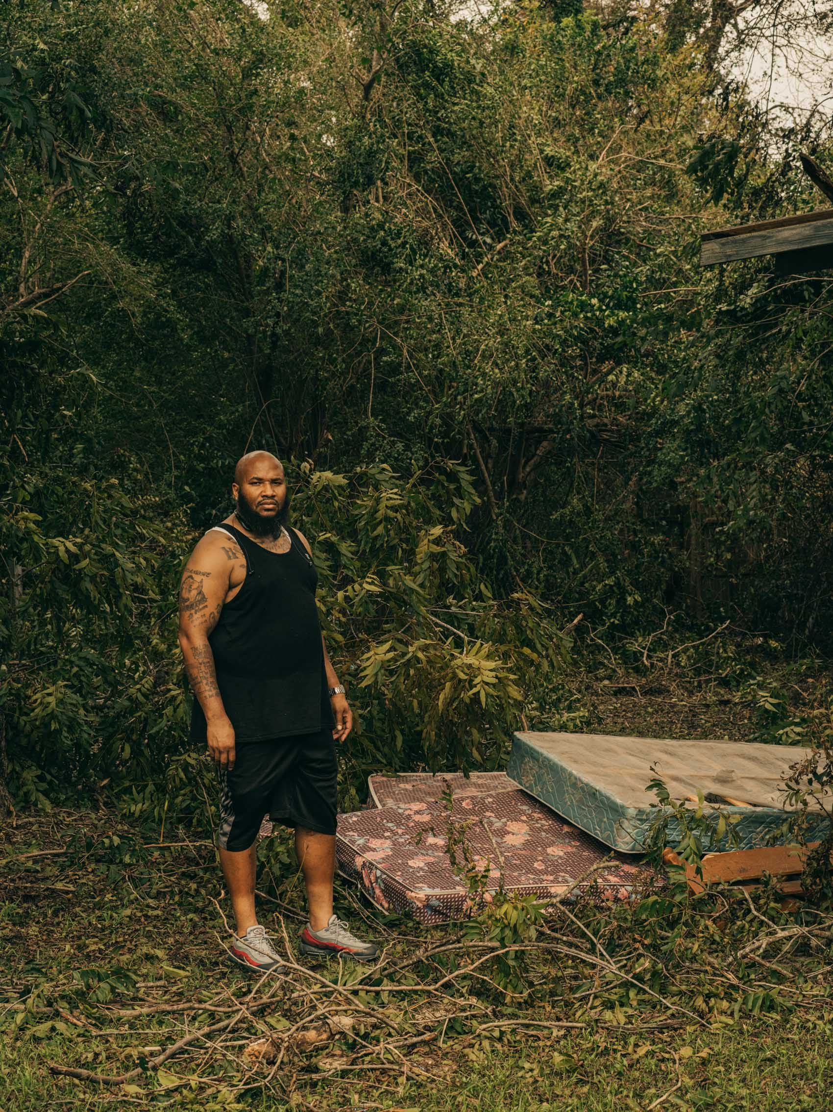 portrait of man at flooded house mattresses Hurricane Florence