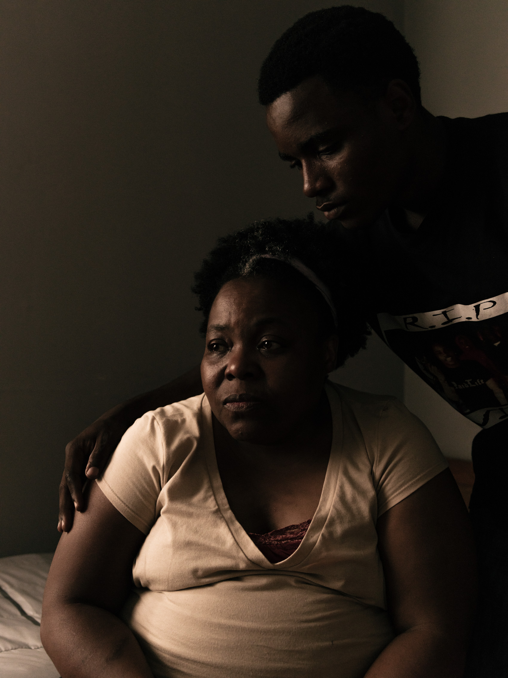 mother crying with son at home in detroit