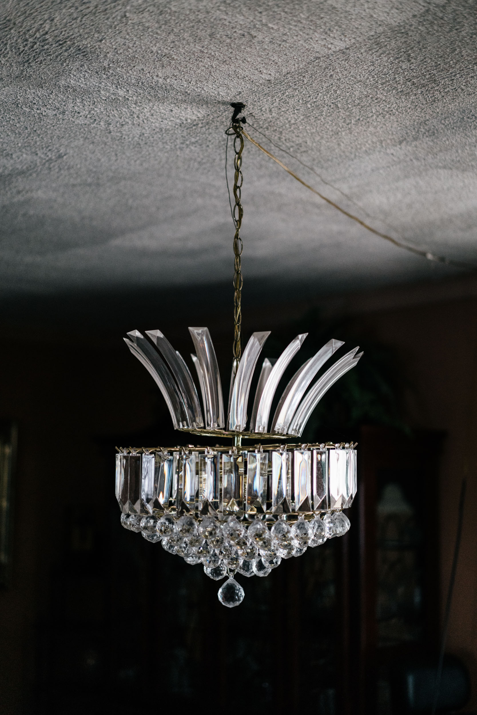 long chandelier in dark room